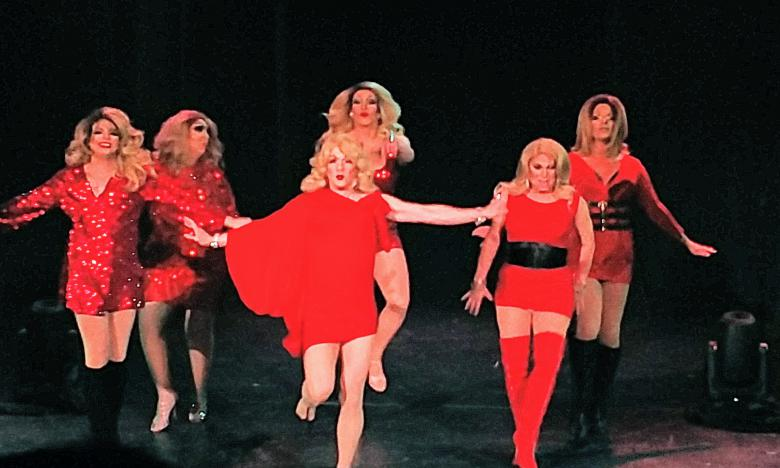 The Rubi Girls performing in red red dress on a stage